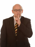 Businessman gesturing quiet Royalty Free Stock Photos