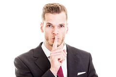 Businessman gesturing for quiet Royalty Free Stock Photos