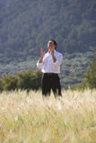Businessman gesturing in rural field Royalty Free Stock Photos
