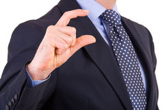 Businessman gesturing small size with fingers. Stock Photo