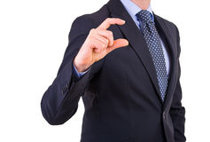 Businessman gesturing small size with fingers. Business man gesturing small size with fingers Stock Photo