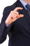 Businessman gesturing small size with fingers. Stock Photography