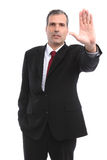 Businessman gesturing STOP with his hand. In a white background Royalty Free Stock Image