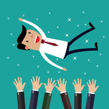 Businessman get thrown into the air by coworkers Royalty Free Stock Photography