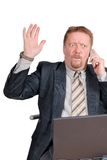 Businessman gets bad news. Travelling businessman or salesman with laptop calling, receiving bad news and raising hand in a despair gesture. Isolated over white Stock Image