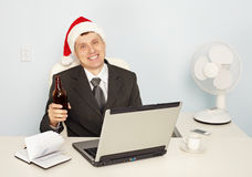 Businessman gets drunk at office before new year Stock Image