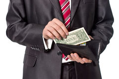 Businessman gets money from pormone. Close-up Royalty Free Stock Photos