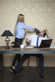 Businessman gets a punch in the face from his employer Royalty Free Stock Image