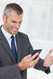 Businessman getting angry after a phone call Royalty Free Stock Photo