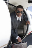 Businessman Getting Down From Airplane Stock Images
