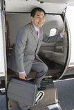 Businessman Getting Down From Private Airplane Stock Images