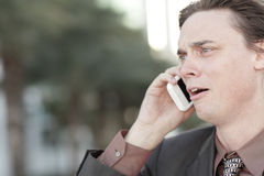 Businessman getting fired over the phone Stock Photo