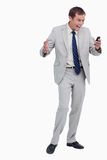 Businessman getting good news via text message Stock Photo