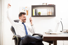 Businessman getting great news on the phone Stock Image