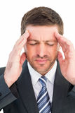 Businessman getting a headache Stock Photos