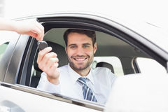 Businessman getting his new car key Stock Photography