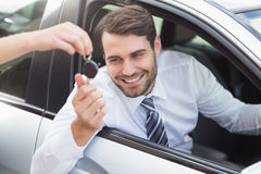 Businessman getting his new car key Stock Photos