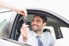 Businessman getting his new car key Royalty Free Stock Image