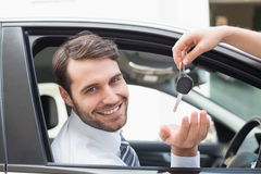 Businessman getting his new car key Stock Image