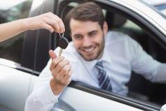 Businessman getting his new car key Royalty Free Stock Photos