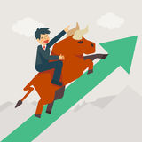 Businessman getting on a large bull market running up Stock Photo