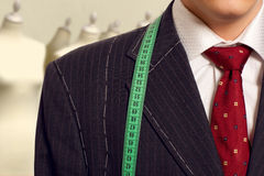 Businessman getting measured by a tailor Royalty Free Stock Photography