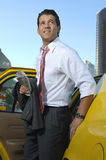 Businessman Getting Out Of Taxi Stock Photography