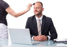 Businessman getting ready for a shooting Stock Photo