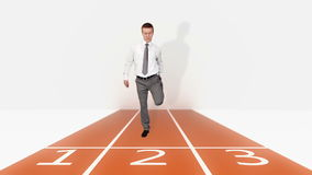 Businessman getting ready for sprint race, stock footage stock footage