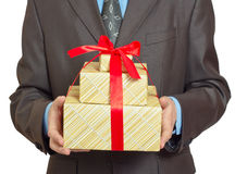 Businessman with gift Stock Image