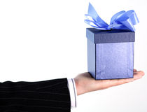 Businessman with gift. Businessman in suit with gift Stock Images