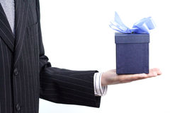Businessman with gift. A businesssman holding in his hand a gift Royalty Free Stock Photo
