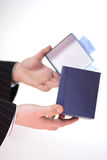 Businessman with gift. A businesssman holding in his hand a gift Stock Photos