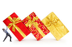 Businessman with gift boxes Royalty Free Stock Images
