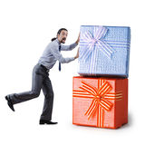 Businessman with gift boxes Royalty Free Stock Photo