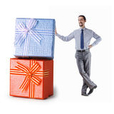 Businessman with gift boxes Royalty Free Stock Image
