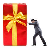 Businessman with gift boxes Stock Images