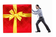 Businessman with gift boxes Royalty Free Stock Photography