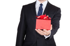 Businessman with gift Stock Photos
