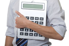 Businessman with gigantic pocket calculator Royalty Free Stock Photos