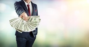 Businessman Give Dollars Cash royalty free stock photo