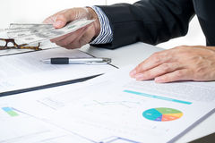 Businessman give money .sign contract.deal.money Royalty Free Stock Photos