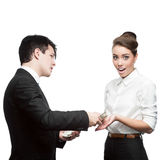 Businessman give money to surprised businesswoman Royalty Free Stock Images