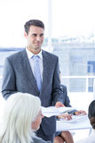 Businessman give a paper Stock Images