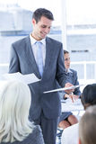 Businessman give a paper Stock Image