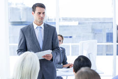 Businessman give a paper Stock Photo