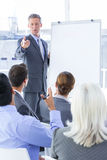 Businessman give a presentation Royalty Free Stock Photos