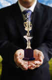 Businessman give soccer trophy, Sccess Royalty Free Stock Photography