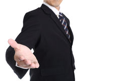 Businessman give some hand to receive something Stock Photos