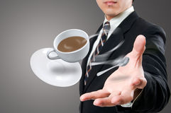 Businessman give to you the coffee cup Royalty Free Stock Images
